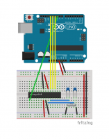 An Arduino flashed with the ArduinoISP sketch, connected to an ATmega on a breadboard with an external oscillator.