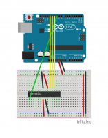 An Arduino flashed with the ArduinoISP sketch, connected to an ATmega on a breadboard.