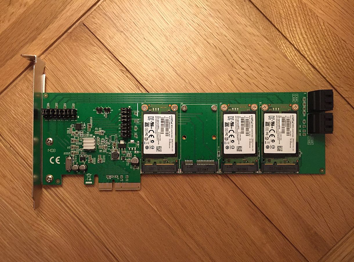 An SD-PEX40079 with three 256GB Crucial m550 mSATA drives attached.